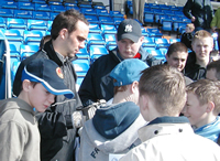 Wayne signs autographs